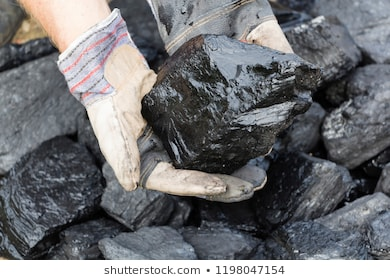 man holding piece coal 260nw 1198047154